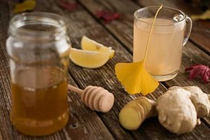 129677565-common-cold-folk-medicine-ginger-root-honey-and-lemon-tea